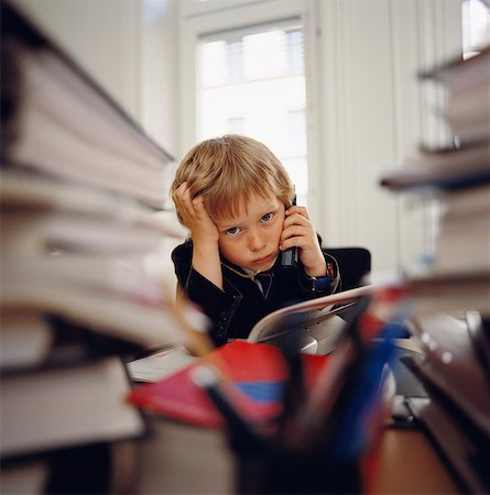 A boy talking on a phone. Stock Photo - Premium Royalty-Free, Code: 6102-03748103