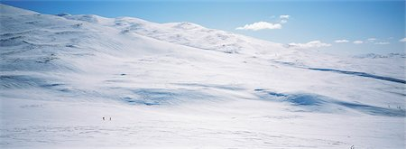 panoramic winter scene - Cross country skiers in snow covered mountain Stock Photo - Premium Royalty-Free, Code: 6102-03858916