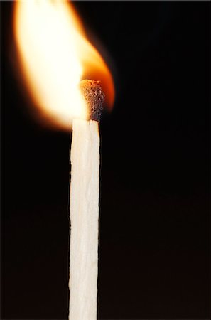 Close-up of flaming match stick against black background Stock Photo - Premium Royalty-Free, Code: 6102-03859108