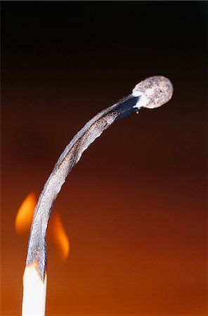 flame - Close-up of flaming match stick against black background Stock Photo - Premium Royalty-Free, Code: 6102-03859109
