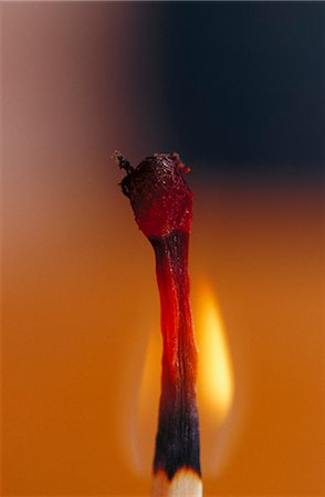 Close-up of flaming match stick Stock Photo - Premium Royalty-Free, Code: 6102-03859111