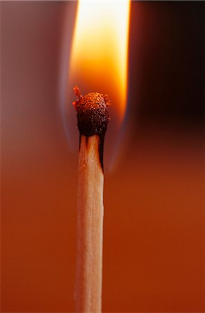 Close-up of flaming match stick Stock Photo - Premium Royalty-Free, Code: 6102-03859112