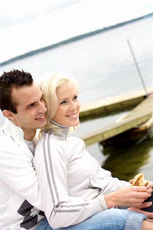 A young smiling couple embracing, Stockholm archipelago, Sweden. Stock Photo - Premium Royalty-Free, Code: 6102-03866303