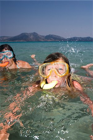 preteen girls bath - Scandinavian girl using a diving-mask, Greece. Stock Photo - Premium Royalty-Free, Code: 6102-03866599