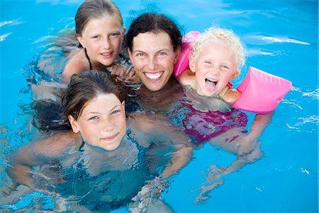 preteen girls bath - Scandinavian mother with her daughters, Greece. Stock Photo - Premium Royalty-Free, Code: 6102-03866607