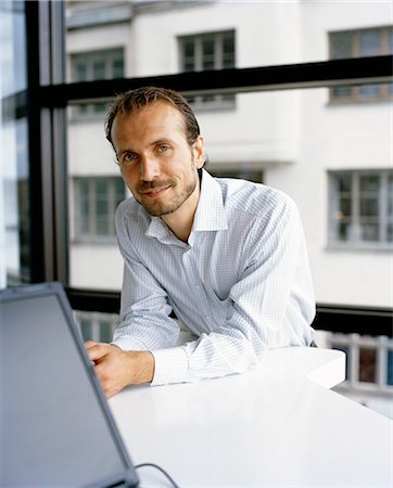 A man in an office, Sweden. Stock Photo - Premium Royalty-Free, Code: 6102-03866725