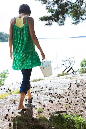 Woman in green dress by the sea, Sweden. Stock Photo - Premium Royalty-Free, Code: 6102-03866843