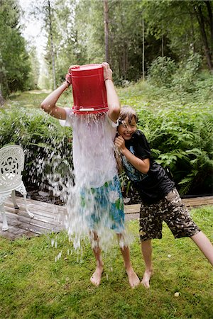 preteen shower pic - Boys playing with water in a garden a summer day, Sweden. Stock Photo - Premium Royalty-Free, Code: 6102-03867252