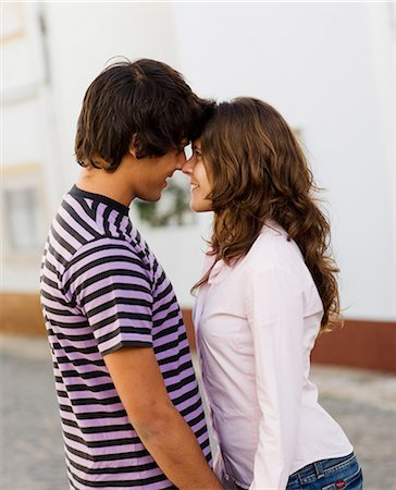 A young couple hugging, Portugal. Stock Photo - Premium Royalty-Free, Code: 6102-03867360