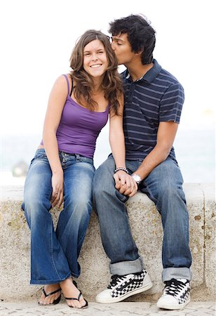 A young couple hugging, Portugal. Stock Photo - Premium Royalty-Free, Code: 6102-03867367