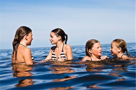 preteen girls bath - Four girls swimming, Oland, Sweden. Stock Photo - Premium Royalty-Free, Code: 6102-03867488