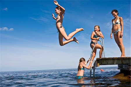 preteen girls bath - Mother and daughters swimming, Oland, Sweden. Stock Photo - Premium Royalty-Free, Code: 6102-03867490