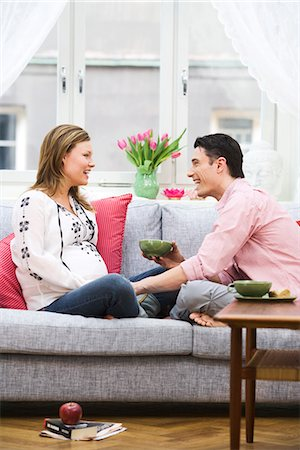 pregnant couple couch - A man and a pregnant woman, Sweden. Stock Photo - Premium Royalty-Free, Code: 6102-03827883