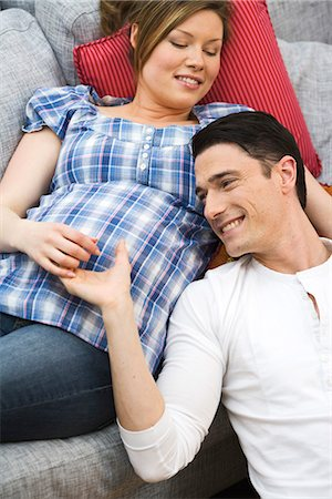 pregnant couple couch - A man and a pregnant woman, Sweden. Stock Photo - Premium Royalty-Free, Code: 6102-03827896