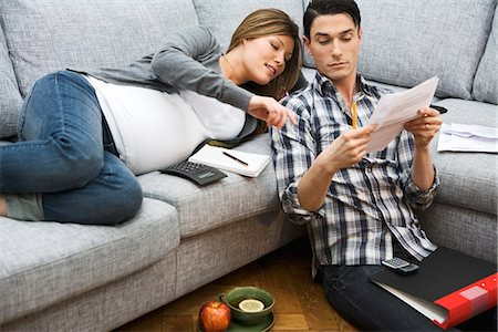 pregnant couple couch - A pregnant woman and a man discussing their home finances, Sweden. Stock Photo - Premium Royalty-Free, Code: 6102-03827899