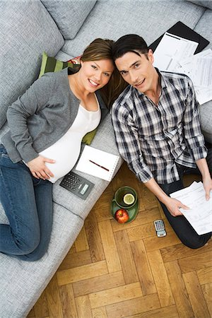 pregnant couple couch - A pregnant woman and a man discussing their home finances, Sweden. Stock Photo - Premium Royalty-Free, Code: 6102-03827907