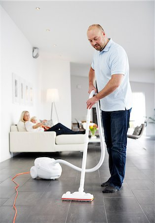 A man vacuuming a floor, Sweden. Stock Photo - Premium Royalty-Free, Code: 6102-03904106