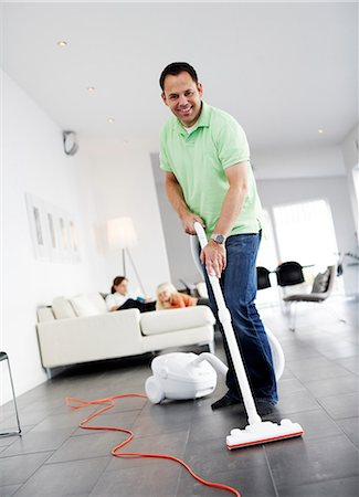 A man vacuuming a floor, Sweden. Stock Photo - Premium Royalty-Free, Code: 6102-03904110