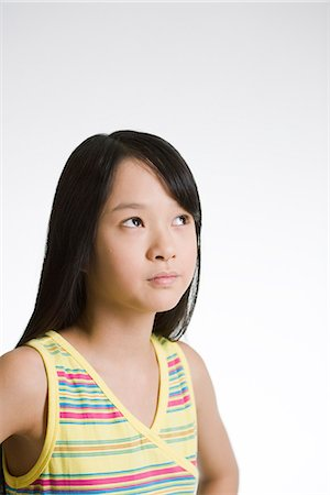 Girl looking up. Stock Photo - Premium Royalty-Free, Code: 6102-03905443