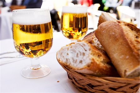 Beer and bread on a table, Spain. Stock Photo - Premium Royalty-Free, Code: 6102-03905592