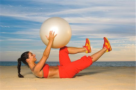 Woman exercising with fitness ball Stock Photo - Premium Royalty-Free, Code: 6102-03905736