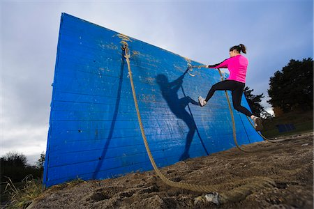 forward - Woman climbing wall using rope in obstacle course Stock Photo - Premium Royalty-Free, Code: 6102-03905979