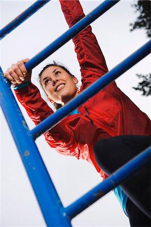 forward - Woman climbing on ladder Stock Photo - Premium Royalty-Free, Code: 6102-03905983