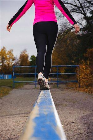 female rear end - Woman walking on hurdles Stock Photo - Premium Royalty-Free, Code: 6102-03905981