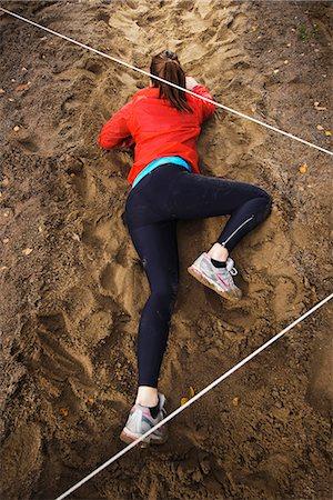 forward - Woman crawling on ground Stock Photo - Premium Royalty-Free, Code: 6102-03905988