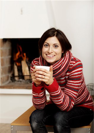 sweater and fireplace - Woman drinking tea near fireplace Stock Photo - Premium Royalty-Free, Code: 6102-03905998