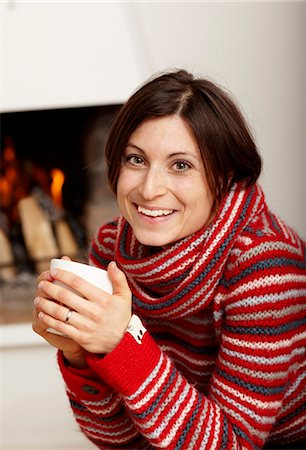 sweater and fireplace - Woman drinking tea near fireplace Stock Photo - Premium Royalty-Free, Code: 6102-03905999