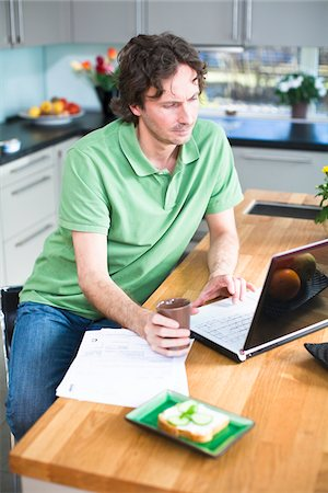 Mid adult man working from home Stock Photo - Premium Royalty-Free, Code: 6102-04929493