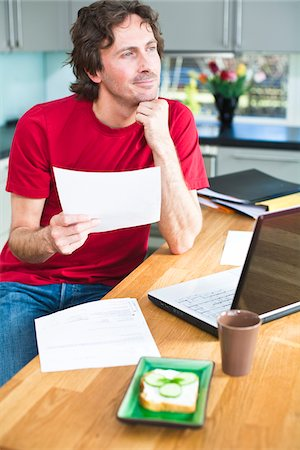 Mid adult man working from home Stock Photo - Premium Royalty-Free, Code: 6102-04929494