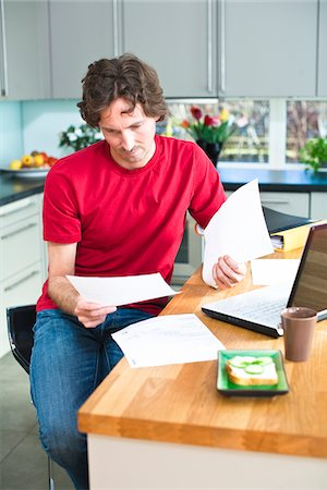 Mid adult man working from home Stock Photo - Premium Royalty-Free, Code: 6102-04929496