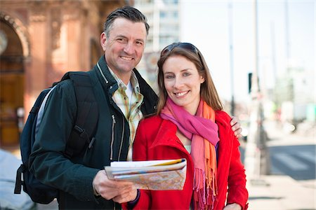 Portrait of couple with map sightseeing in city Stock Photo - Premium Royalty-Free, Code: 6102-04929600