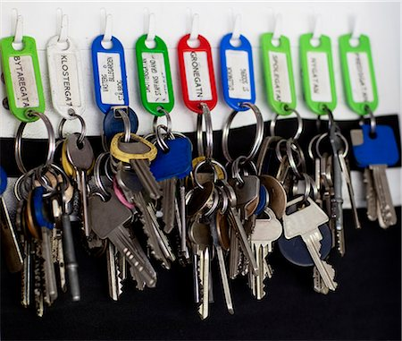 Keys hanging in row, close-up Stock Photo - Premium Royalty-Free, Code: 6102-05655446