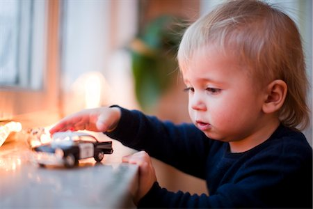 Boy playing with toy car Stock Photo - Premium Royalty-Free, Code: 6102-05603690