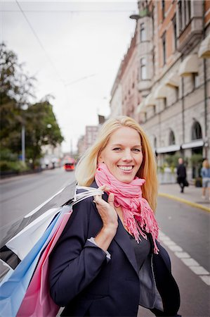 stockholm - Portrait of woman with shopping bags in street Stock Photo - Premium Royalty-Free, Code: 6102-06025962