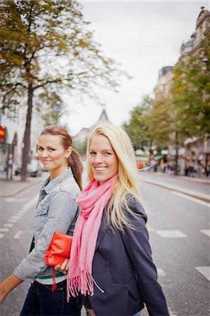stockholm - Portrait of two women walking in street Stock Photo - Premium Royalty-Free, Code: 6102-06025972