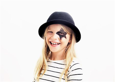 stars on white background - Smiling girl wearing hat, studio shot Stock Photo - Premium Royalty-Free, Code: 6102-06374469