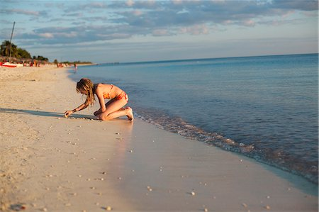 Girl on beach Stock Photo - Premium Royalty-Free, Code: 6102-06374483