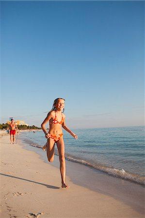 Girl running on beach Stock Photo - Premium Royalty-Free, Code: 6102-06374484