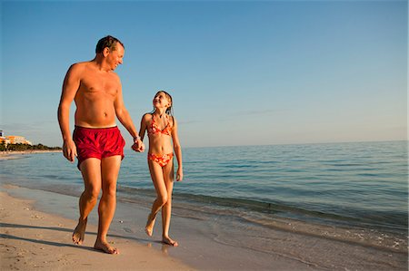 preteen girls bath - Father with daughter walking on beach Stock Photo - Premium Royalty-Free, Code: 6102-06374485