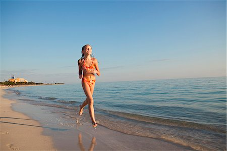preteen girls bath - Girl running on beach Stock Photo - Premium Royalty-Free, Code: 6102-06374486