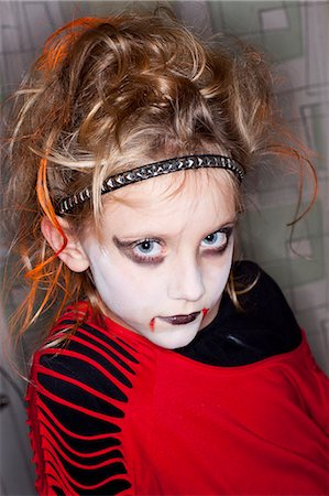 Portrait of girl with Halloween make up Stock Photo - Premium Royalty-Free, Code: 6102-06374495