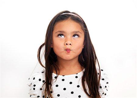 Portrait of girl making face, studio shot Stock Photo - Premium Royalty-Free, Code: 6102-06336535