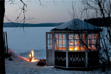Fire in front of gazebo on snowy landscape Stock Photo - Premium Royalty-Free, Code: 6102-06336722
