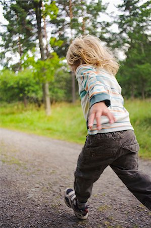 running away scared - Child running through forest Stock Photo - Premium Royalty-Free, Code: 6102-06336727