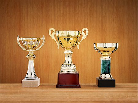 Trophies on wooden background Stock Photo - Premium Royalty-Free, Code: 6102-06336815