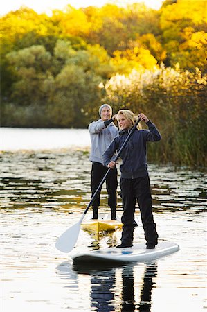 Two people on paddle boards on river Stock Photo - Premium Royalty-Free, Code: 6102-06336951